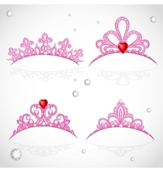 Set openwork pink tiaras with diamonds and faceted vector