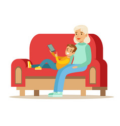 Grandmother and boy reading electronic book part vector
