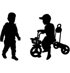 Silhouettes of two toddlers vector