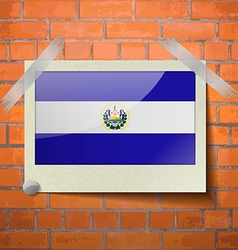 Flags el salvador scotch taped to a red brick wall vector