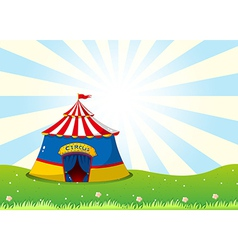 A circus tent at the top of the hill vector