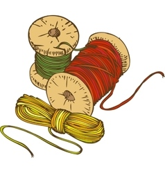 Three color spools of thread vector