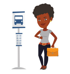 Woman waiting at the bus stop vector