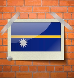 Flags nauru scotch taped to a red brick wall vector
