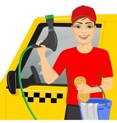 Smiling teen boy washing a taxy car vector