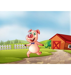A playful pig with a barn at the back vector