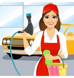 Smiling young girl washing a car vector image