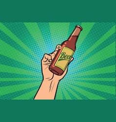 beer bottle in hand vector image vector image