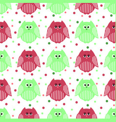 Cute green and carmine owls with dots in the vector