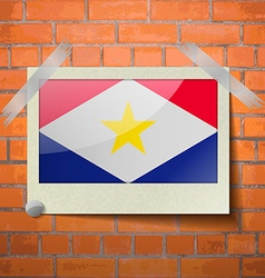 Flags saba scotch taped to a red brick wall vector