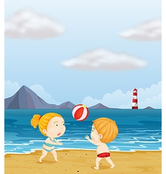 A girl and a boy playing volleyball at the beach vector image