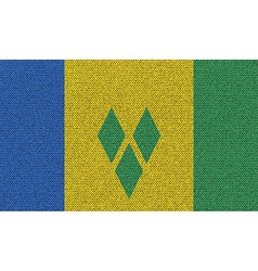 Flags saint vincent grenadines on denim texture vector