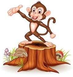 Cartoon Happy monkey presenting on tree stump vector image vector image