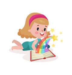 cute little girl lying on her stomach and reading vector image vector image