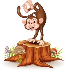 Cartoon happy monkey dancing on tree stump vector image vector image