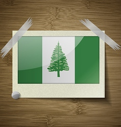 Flags Norfolk Island at frame on wooden texture vector image