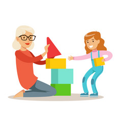 girl and grandmother building pyramid from blocks vector image