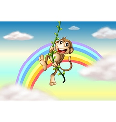 A monkey hanging on a vine plant near the rainbow vector