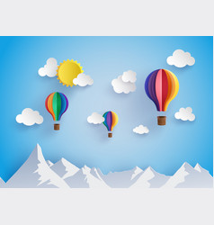 Colorful hot air balloon flyin over moutain vector