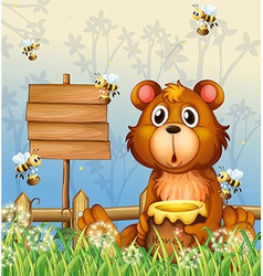 A bear and bees near a signage vector image