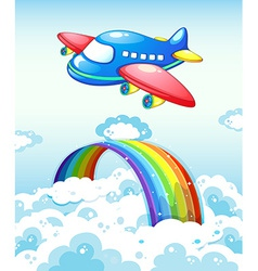 Airplane and rainbow vector image vector image
