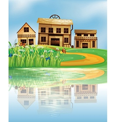 A pond with a reflection of the wooden houses vector