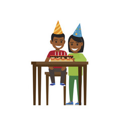 Boy and girl at table with happy birthday cake vector