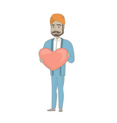 Hindu businessman holding a big red heart vector