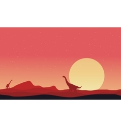 Brachiosaurus on hills landscape at afternoon vector