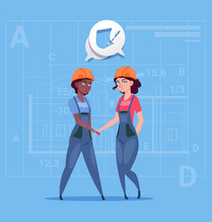 two mix race female builders shaking hands vector image vector image