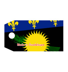 Guadeloupe flag on price tag with word made in vector