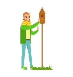 Man instralling bird house contributing into vector