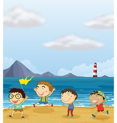 Four boys playing at the beach vector image vector image