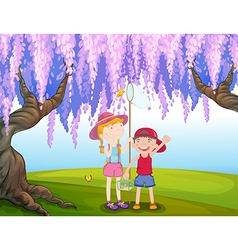 A girl and a boy catching butterfly at the park vector image vector image
