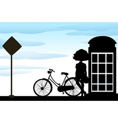 Silhouette of woman standing with bicycle vector image