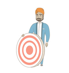 Young hindu businessman and dart board vector