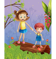 A young lady with a young boy in the forest vector image