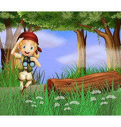 A girl with a telescope inside the forest vector image