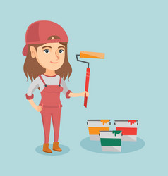 young caucasian painter holding a paint roller vector image