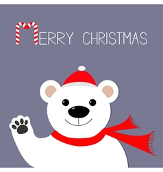 White polar bear in santa claus hat and scarf paw vector