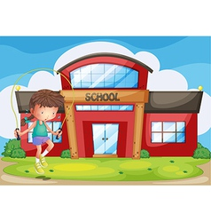 A girl playing in front of the school vector image