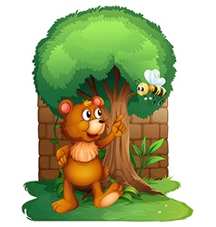 A bear and the bee with a big tree vector image vector image