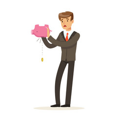 Businessman shaking an empty piggy bank vector