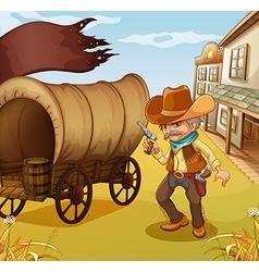A Mexican man holding a gun beside a wagon vector image
