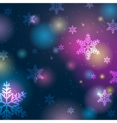 Bright blue background with bokeh and snowflakes vector