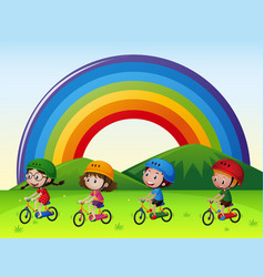 four kids riding bike in the park vector image
