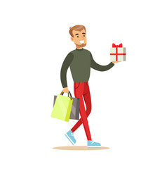 Elegant young handsome man with gift box and vector