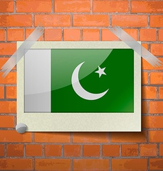Flags pakistan scotch taped to a red brick wall vector