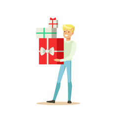 Happy young man standing and holding gift boxes vector
