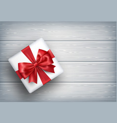Present gift box with bow on wooden vector